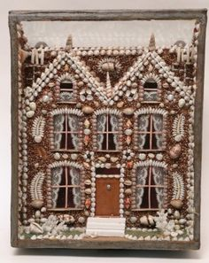 Antique twin peaks shell encrusted house in shadowbox. Height 13 ¼ in. Width 10 ½ in. Diameter 5 in.  Provenance: The Estate of Richard Mellon Scaife
