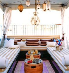 Something like this for under the pergola....minus one bench so it still feels open. I like the comfy bench idea...and the curtains that close for more privacy from our neighbors to the left.