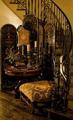 This heavy decor compliments the wrought iron staircase