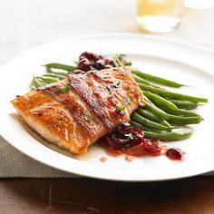 This bacon-wrapped salmon fillet makes a mouthwatering meal topped with a simple cranberry and apricot jam compote./