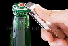 Bottle Opener USB Flash Drive  Modern bottle opener comes with built-in flash memory drive.