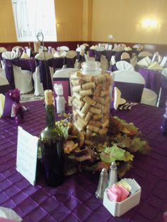 cool tall wine themed wedding centerpieces with a purple table
