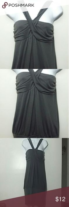 Girly and Sassy criss cross Top So sexy with and super fun with cross cross detail. Great for a night out with the girls.  Some say this can be worn as a dress depending on your height I'm 5'5 and I'm conservative.  Jeggings,  leggings yes. Tops Blouses