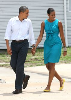 United States President Barack Obama with First Lady Michelle Obama walk out to speak at a Coast Guard base August 14, 2010 in Panama City Beach, Florida. The First Family is visiting the area to help promote tourism and check up on cleanup efforts from the aftermath of theDeepwaterHorizon Oil spill.Photo Credit: Dan Anderson-Pool, Getty Images via StyleList
