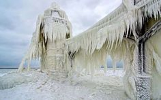 """""""Barely recognizable under a thick coating of ice, the St. Joseph, Michigan outer light, withstands ... - Courtesy of Tom Gill"""