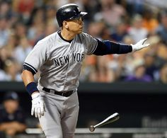 ALEX RODRIGUEZ THROUGH THE YEARS: -   2,000 RBIs -        New York Yankees' Alex Rodriguez drops his bat after hitting a two-run home run against the Baltimore Orioles during the sixth inning June 13, 2015, in Baltimore. With his 666th home run, Rodriguez passed the 2,000 RBI threshold and notched career hit No. 2,995.  - © Gail Burton/AP