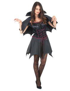 Disfraz de vampiresa negro mujer Halloween: Este disfraz de vampiro para mujer incluye capa y vestido (peluca, látigo y zapatos no incluidos).La parte superior es negro con detalles violetas y una lazada.El bajo del vestido simula el...