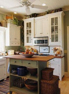 Cottage Kitchen...love the white cabinets w/ the windows and that island!
