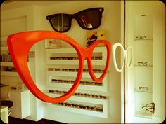 Super statement eyewear! 6th August 2012 Ottica iSee is in Santa Maria degli Angeli, just near the pretty medieval town of Assisi in Italy. The store concentrates on special labels like BlueMagicEye, Claire Goldsmith, Massada and Ksubi. I recently saw their window, a work of art featuring colourful, giant specs. - Ottica iSee