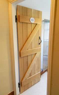 Solid Oak Ledged and Braced Door. Traditional Cottage Door. http://www.ukoakdoors.co.uk/oak-ledge-and-brace-door_p23637763.htm