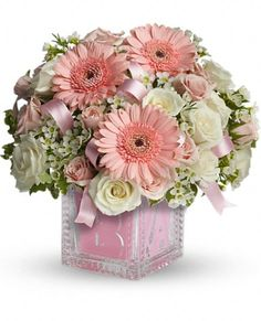A keepsake glass Baby Block cube vase. The glass block can be used later in baby's room and makes a memorable baby girl present. Baby's First Block by Teleflora - available in pink or blue. .