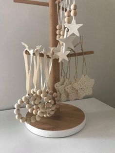 Wooden bead wreaths and crotchet stars Christmas decorations Classy Christmas, Natural Christmas, Rustic Christmas, Christmas Crafts, Beaded Christmas Decorations, Christmas Tree Ornaments, Christmas Projects, Holiday Crafts, Wooden Beads