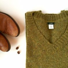 Green wool sweater • J. Crew Perfect condition. Short sleeve wool sweater. Color true to first two photos. Make an offer, no trades :) J. Crew Sweaters