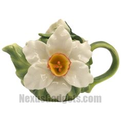 This exquisite porcelain teapot has a narcissus attached to each side. The tea pots cap has a leaf with a budding narcissus on it.