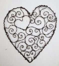 Burly Barbed Wire Heart of Spirals Trellis:  I love this guys art!