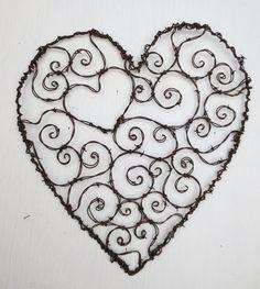 Burly Spirillian Barbed Wire Heart of Spirals For Your Valentine Garden Trellis. $ 75.00, via Etsy.