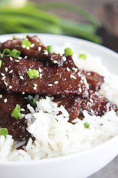 Copycat P.F. Chang's Mongolian Beef Recipe ~ Tender strips of beef cooked in a rich sauce... so easy and so crazy delicious!