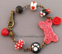 The Dog Mom bracelet below has a fabulous vintage style and includes a sweet red rose, vintage brass filigree bead and floral clasp, and che...