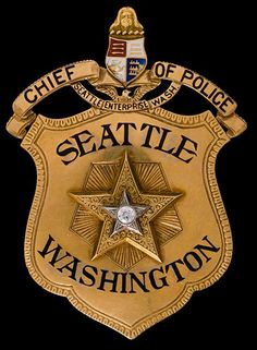 Probably the 1923 Chief of Police (of Seattle WA) badge with a diamond inlay