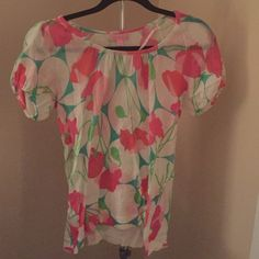 Lilly Pulitzer short sleeved flowered sweater Lightweight size small Lilly Pulitzer short sleeved sweater.  Worn once! Great summer top that goes well with white denim. Loose fit. Lilly Pulitzer Sweaters