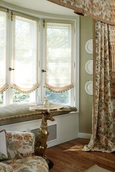 Love this for bay window area. Sheer soft  Roman shade and window seat, set off with full draperies.