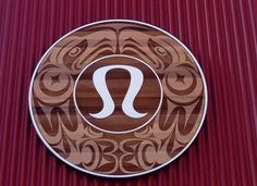 Jody Broomfield was commissioned Lululemon to create the design for this store front sign, featuring a double sided Thunderbird with the Lululemon flip in the middle. Measures: 8ft round. Medium: Red Cedar & paint. Location: Park Royal Village, West Vancouver, BC.