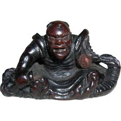 19th Century Antique Hard wood Netsuke of a Samurai, new regular price almost at cost. Extremely nice netsuke and old wood other than his war injury.