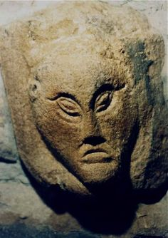 Mysterious carving inside 10th century St. Cronin's church Tuamgraney, Ireland.  LOOK AT THOSE EYES!
