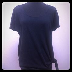 "Express Black Oversized Top with Cute Side Tie Black oversized tee, round neck, gathered sleeves, ties at side.  Excellent condition.  Approx measurements laying flat: chest 21"", length 26.5"". Express Tops Tees - Short Sleeve"