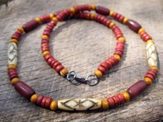 Reminds me of Zuko, it has the colors of the fire nation. looks like a fire bender necklace.   Mens surfer necklace bone horn wood and by thehappymushroom, £10.50