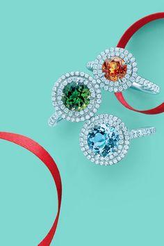 Tiffany Soleste® rings in platinum with round brilliant diamonds, from top: Spessartite, Tsavorite, and Aquamarine. #TiffanyPinterest