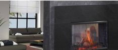 """The Simplifyre See-through electric fireplace creates a dramatic room divider that can literally go anywhere. No venting. No gas lines. It's easy to install, just plug it in to any 110 volt outlet. It's the industry's first, and only, see-through electric fireplace. The generous 27"""" x 20"""" viewing area on both sides shows off the realistic-looking flickering flame and logs. Comes standard with on/off control and fixed glass doors for both sides."""