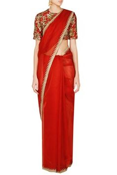 Featuring a red organza saree with a gold dori work border. It is paired with a matching floral printed silk blouse highlighted with sequins. Shop now www.carmaonlineshop.com. #carma #carmaonlineshop #sabyasachi #redandgold #sequins blouse #shopnow #onlineshopping #bridal #bridesmaids #saris #indianfashion #red #blouse