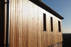 Cedar wrapping around a house extension.