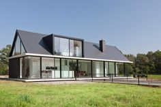 barn style homes photos | modern-barn-style-home-showcases-glazings-below-grade-ramp-2-site.jpg