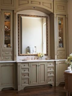 Floor-to-Ceiling Bathroom Vanity Cabinets - Add a twist to your vanity by extending storage space from floor to ceiling.This vanity's beaded doors and pilasters provide the elegance of fine furniture, while a gilded antique mirror topped by an arched valance enhances its vintage charm. Sage-green paint brings a hint of color to the retreat. Beautiful Bathrooms, Modern Bathroom, Small Bathroom, Master Bathroom, Bathroom Ideas, Shiplap Bathroom, Mirror Bathroom, Industrial Bathroom, Budget Bathroom