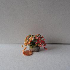 Miniature pot of Nasturtiums by Kiki Bean Minis.1 inch scale.