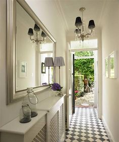 like lights, mirror, radiator covers and light airey feel in the hallway