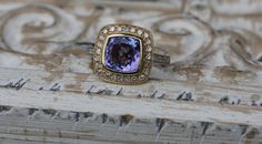 Tanzanite cushion white and yellow gold diamond ring. $1,750.00, via Etsy.
