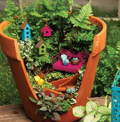 Love the brightly colored accessories and great use of a broken pot.