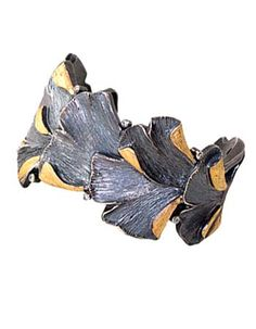 Gingko Cuff by Davide Bigazzi. Bracelet in sterling silver, 18k yellow gold and white diamonds. Approx 1 1/2