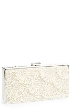 This pearl encrusted clutch is simply elegant.