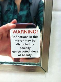 Reflections in the mirror may be distorted by socially constructed ideas of beauty.