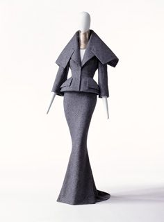 Suit and Choker  Autumn/Winter 1997  Designer:   John Galliano  Brand:   Christian Dior  Label:   Christian Dior HAUTE COUTURE AH97 PARIS (Stamp AH97 29374)  Material:   Set of jacket and skirt of gray wool tweed; pad at jacket hem; train with long skirt; choker of 35 rings of two-toned silver.