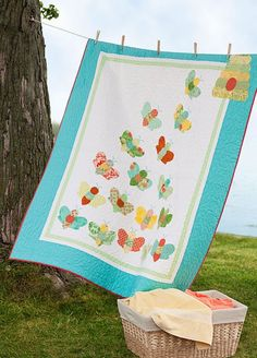 """Fast fusible appliqués stitched atop foundation strips make this buzz-worthy  quilt cute as can """"bee."""""""