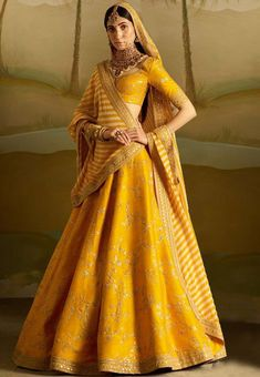 Gear up for the upcoming festive days with 15 Yellow Lehenga Choli designs. These gorgeous chaniya choli designs are perfect for day and night parties! Lehenga Choli Designs, Bridal Lehenga Choli, Lehenga Wedding, Ghagra Choli, Lengha Design, Lehenga Indien, Indian Bridal Outfits, Indian Bridal Wear, Indian Outfits
