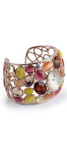 Buy Online from the link below http://www.kalkifashion.com/multi-coloured-gem-stone-cuff.html