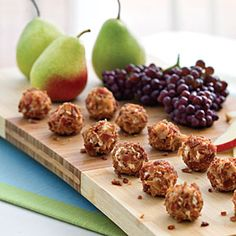 Gorgonzola Truffles  calls for:  4 ounces cream cheese, softened   1 (4-oz.) container crumbled Gorgonzola cheese   2 teaspoons finely chopped onion   1/2 teaspoon Worcestershire sauce  1/4 teaspoon black pepper  1/2 cup cooked and crumbled bacon   Apple and pear slices   Grapes