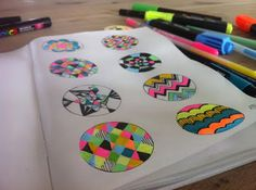 In sketchbook: create 8 different patterns in the circles. Use repeating lines, shapes and colors