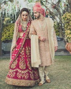 Luxurious Bridel Groom Dress In Red Lahnga Choli And Pinkish Sherwani.Bridal Lahnga Choli With Pure Dabka,Zari,Nagh,And, Threads Work.Groom Sherwani Based On Pure Jamawar Fabric In Light Pinkish Color. Indian Wedding Lehenga, Wedding Dresses Men Indian, Wedding Sherwani, Indian Bridal Outfits, Bridal Lehenga Choli, Indian Bridal Wear, Gold Lehenga, Wedding Dresses For Groom, Sherwani Groom